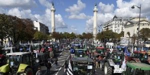 Farmers arrive in Place de la Nation in Paris to take part in a national demonstration on September 3, 2015, to protest against the falling prices that they say are endangering their livelihoods. The protest comes after months of unrest as farmers in the dairy and meat industries become increasingly desperate in the face of plummeting food prices which they blame on foreign competition, as well as supermarkets and distributors. AFP PHOTO / ERIC FEFERBERG