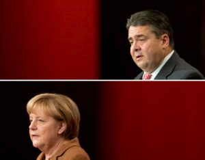 COMBO - Acomposite image made available on 18 October 2013 shows SPDchairman Sigmar Gabriel (18 Ocotber 2013) and German Chancellor Angela Merkel (16 October 2013) talking during the 5th union congress of the IG BCEunion at the Congress Center in Hanover, Germany, 18October 2013. Photo: JULIANSTRATENSCHULTE