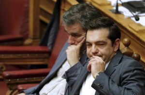 Greek Prime Minister Alexis Tsipras (R) sits next to Finance Minister Euclid Tsakalotos (L) as he attends a parliamentary session in Athens, Greece July 16, 2015. Tsipras battled to win lawmakers' approval on Wednesday for a bailout deal to keep Greece in the euro, while the country's creditors, pressed by the IMF to provide massive debt relief, struggled to agree a financial lifeline.      REUTERS/Christian Hartmann