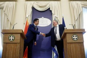 Greek Foreign Minister Nikos Kotzias (R) shakes hands with his Macedonian counterpart Nikola Dimitrov during a news conference following their meeting at the Foreign Ministry in Athens, Greece, June 14, 2017. REUTERS/Costas Baltas