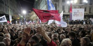Supporters of Alexis Tsipras, leader of Greece's Syriza left-wing main opposition party attend his pre-election speech at Omonia Square in Athens Thursday, Jan. 22, 2015. Prime Minister Antonis Samaras' New Democracy party has failed so far to overcome a gap in opinion polls with the anti-bailout Syriza party ahead of the Jan. 25 general election. (AP Photo/Lefteris Pitarakis)