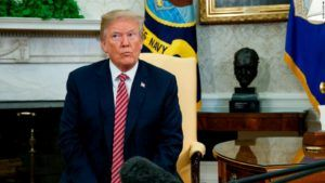 President Donald Trump listens during a meeting with the Emir of Qatar Sheikh Tamim bin Hamad al-Thani in the Oval Office of the White House, Tuesday, April 10, 2018, in Washington. (AP Photo/Evan Vucci)
